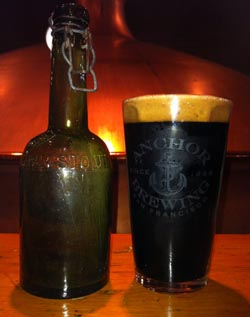A bottle of London Double Brown Stout and a pint of Flying Cloud San Francisco Stout