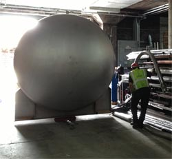 Moving a new cellar tank into place.